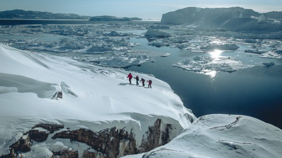 Snowshoeing near Sermermiut on the edge of the Ilulissat ice fjord in Greenland