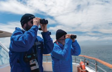 Day at Sea, guest with expedition staff looking for birds, 7725, Denis Elterman